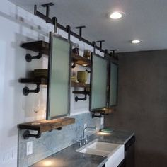 vintage industrial with plumbing pipes and wood integrated with mirrors for storage