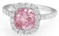 This ring will absolutely take her breath away! It features an eye catching pastel peachy pink unheated padparadscha sapphire in a cushion cut. This sapphire is so unbelievably rare and special. Only padparadscha sapphires have that delicate and desirable combination of peach and pink, and this beautiful sapphire is also completely natural and unheated.