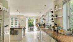 Love the wooden counter top against the all white