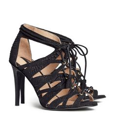 lace-up snakeskin sandals. Pair with boyfriend jeans and a rocker tee or a crop top/high-waisted print skirt.