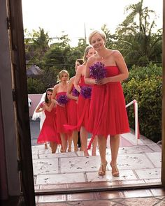 Coral dresses from J.Crew and purple orchid bouquets