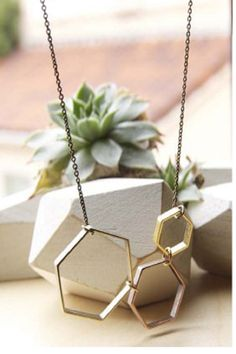 A Mano Trading shape shifter necklace with mixed metal finishes on hexagons (18in)
