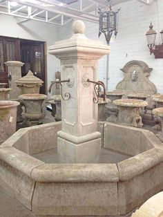 Here we have a very grand hand craved limestone central fountain from France. This fountain has 4 spouts and flower motif carvings on each side of the column. Origin: France Measurements: 7'4″H x 7'8″D Surround: 1'8″H If you are interested in purchasing this item, please email infopittetarch@gmail.com. SKU: FO20