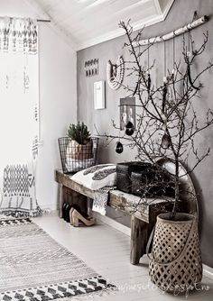 Gray palette, textured elements, patterned rug, gallery wall, contemporary eclectic design
