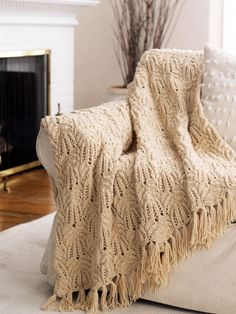 Free Pattern - Pretty lace and cable afghan brings a rich touch of elegance to your home.