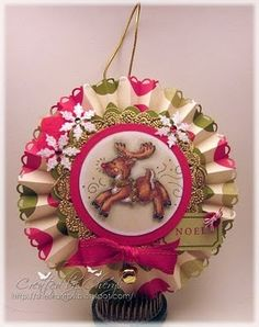 Cheryl made this super cute ornament  from a paper rosette!  I think I am the last person on earth who hasn't used a border punch on the edg...