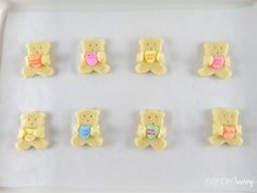 This Valentine Day Sugar Cookie recipe w/ bears holding conversation hearts. Very easy to make and so fun that the kids will help.