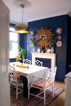 HOUSE TOUR - Kim Hughes. More convincing proof that EVERY room should have at least one dark/navy blue wall with something gold on it.