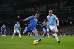 Willian and Vincent Kompany battle for the ball