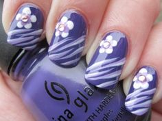 Love this!  Though I would do the stripes on each finger, with the flower just on one.