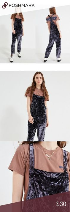 """Blue Crushed Velvet Street-Style UO Overall No-frills overall in the perfect relaxed fit. Luxe-to-the-touch fabrication that drapes the body with super-low sides + slim cross-strap racerback. Finished with a cropped straight-leg. Perfect for layering.  Content + Care - Linen, rayon  - Measurements taken from size Small - Waist: 20.75"""" - Inseam: 24.75"""" - Rise: 23"""" Urban Outfitters Pants Jumpsuits & Rompers"""