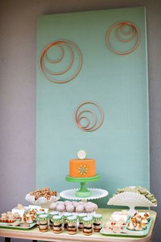 Baby shower table -- hoops and cakes in a jar