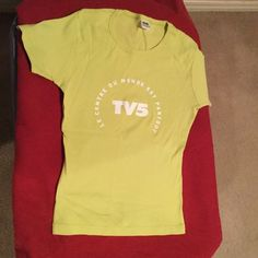 French TV Network Souvenir TShirt BUY 1, 2nd $3 French TV Network TV5 whose Motto loosely Translates to The World is all around Us. Light Lime Green Size W for Women which translates to a Fitted Size SMALL Frame. Purchased from their Online Store. T-Shirt is 100% Cotton and Made in the USA. Care Label is Machine Wash Cold, Delicate Dry. Gently Worn and in Good Condition. One or Two Small Areas of Discoloration and one or Two Fabric Weave Irregularities. Smoke and Pet Odor Free. TV5 Tops Tees…