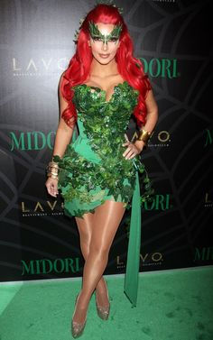 Kim Kardashian is almost unrecognizable as a redhead in this Poison Ivy costume.