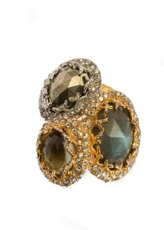 """The Alexis Bittar brand has established a reputation for stylish jewelry designs that are both elegant and stylish with beautiful attention to detail on every piece. From the Siyabona Collection, this organically shaped three stone ring is stacked with Labradorite, Quartz and Pyrite. Decorative gold plated settings encrusted with Swarovski crystals lends a mystical feel that is both elegant and fierce. Ring is a size 7.Labradorite is oval 3/4"""" length and 1/2"""" width."""