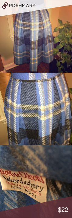"Vintage Plaid Skirt Blue, dark gray and cream Pleated Plaid vintage skirt. Zipper and button closure. Waist does not stretch. Best fit for a size small. Waist 27"" and length 26"". No defects. VINTAGE Skirts"