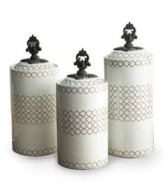 These antique-style canisters lend a touch of vintage flair to countertops, mantelpieces or bedroom sets and are perfect for filling with potpourri, keepsakes or candies.