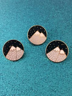 A gold shiny Mountain pin :)  This pin measures about 1 inch (25mm)  - Please read my shipping and refund policies before purchasing.  - Shipping: All packages ship through USPS either First-Class Mail® or Priority Mail®. Tracking number provided with all U.S. orders.  - International: Please note, ALL international orders take anywhere from 2 to 8 weeks to arrive. It is not uncommon for it to take all 8 weeks. Please keep this in mind when ordering. Shipping upgrades are offered at…