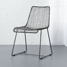 live wire.  Antiqued zinc plated iron wires warp and weft, wrap and weld surprisingly comfortable contours.  Handwoven to graphic extreme with exposed handwelding at each crosspoint and edge wrap.  Sits squarely on sleigh legs with stability bar. Antiqued zinc plated iron wire is handwovenExposed handwelding detailProtective glides includedEach is uniqueMade in India.