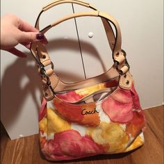 Coach floral bag Authentic!! Used once - perfect condition!!Decided it was to small for me. 3 pocket floral purse, zipper in the middle and open pockets on either side. Coach Bags Shoulder Bags