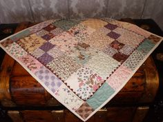 """Today I'd like to share a quick and easy table topper I made yesterday from a Moda charm pack, 2 yards of 1/2"""" (or 5/8"""") ric rac, and 7/8 y..."""