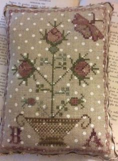 My Pink Rose is the title of this cross stitch pattern from Blackbird Designs that is stitched with Classic Colorworks (Country Lane) and Gentle Art Sampler threads (Cidermill Brown, Endive, Loganberry, Mountain Mist and Raspberry Frost) or DMC threads.