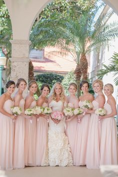 Blush bridesmaid dresses | Tina Sargeant Photography | http://www.theknot.com/submit-your-wedding/photo/36142d0a-cfeb-4908-aac1-0960316b9254/Spring-in-a-Winter-Park-FL-Wedding