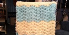 "I loved these colors together and immediately thought ""Chevron!"" I love the texture of this blanket!  :) Materials: * H Hook *Lion Br..."