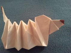 """For now, I am putting away dollar bills. No, not saving them, just not using them for Origami. Here is a """"Slinky-like Dachshund"""" I saw on Origami Expressions which cited another websit…"""