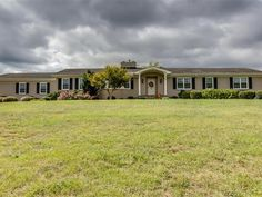 Over 19 acres of rolling pasture and woods located between Greenville and Spartanburg.  Bring your horses 4 wheelers kids and family as this property has something for everyone.  TOTALLY RENOVATED WITH A NEW MASTER SUITE ADDITION.  After you enter the foyer the formal living room is to your left and features wood burning fireplace surrounded by built-in bookcases butlers pantry and bay window. If you enter from the garage there is plenty of storage for every member of your family to put…