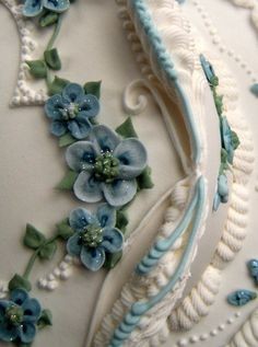 Lamberth style royal iced cake with piped sugar flowers.