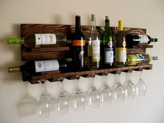 DIY pallet furniture using wood pallets that had been around for decades as mechanisms for shipping.Pallet furniture ideas from crafters around the World! Wood Pallet Wine Rack, Wood Wine Racks, Pallet Wood, Diy Pallet, Wooden Pallet Furniture, Wooden Pallets, Bar Deco, Hanging Wine Rack, Pallet Home Decor
