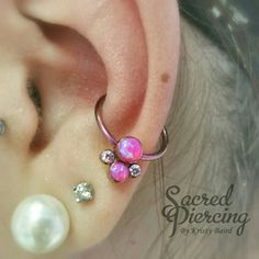 Kacey prettied up her healed conch piercing with this awesome hot pink opal captive cluster from Anatometal.  Sacred Piercing 814-454-3004 www.sacredpiercing.com
