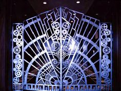Bronze gates leading to Irwin Chanin's offices, designed with symbolic ornament representing individual aspects of the greatness of New York City.