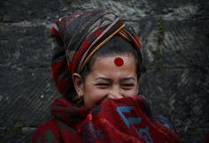 A devotee smiles while speaking with her friends after taking a holy bath in the Bagmati river at Pashupatinath Temple in Kathmandu… (Swasthani festival) by Navesh Chitrakar Bindi, Just Smile, Tween, Portrait Photography, Winter Hats, Take That, People, Nepal, Spirituality