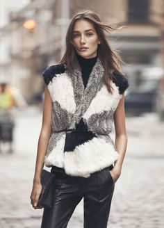 Look 5 | Vince fur vest, sleeveless turtleneck. med clutch - skinny belt?