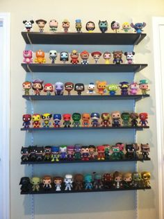 I'm really liking the idea of ledge shelves. Can put them up out of the reach of little hands
