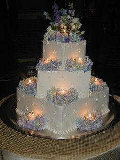 Square Wedding Cake with Flowers and Tealights. Just need to change the colors to pink and yellow.