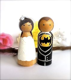 Super Hero WEDDING CAKE TOPPERS Superhero Cake Topper Custom Cake Topper Bride and Groom Wood Peg Doll Comic Book Wedding Cake Topper Cute. $70.00, via Etsy.