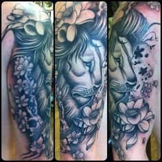 Black and grey Lion tattoo with flowers