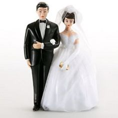 In true vintage style, a 1959 wedding cake topper.