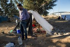 An Unrelenting Crisis by Lynsey Addario- Slide Show - NYTimes.com Zakaria Deeb, 31, stands in front of his tent in a squatters camp outside of the Kilis refugee camp. He had traveled 100 miles with his family, chasing a false rumor that refugees would be allowed into a Turkish-run camp.  Instead, the Deebs were now squatting in a gravel strewn field across from the camp sleeping under plastic sheets hanging from a cypress tree.