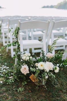 Simple wedding ceremony flowers, greenery