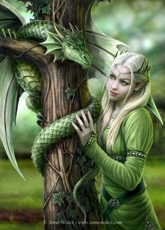 Image detail for -Anne Stokes Fantasy Art | Design Stuff Daily | Design and Inspiration. Blond-haired girl in a green medieval dress and an ivy hairpiece, standing by a green dragon around an ivy-covered tree.