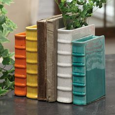 we have so many books, we don't really have room for bookends; but these would be nice to mock up with real hollowed books.//Terracotta Bookend Vase - HolyCool.net