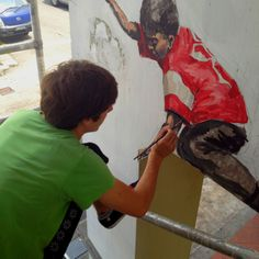 Artist Ernest Zacharevic working on mural at Perak Hotel in Little India. Pic taken by Jennifer.
