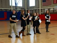 SJHS senior STAFF members hosting an Xplorathon for 7th and 8th grade students from Mary Queen of Apostles.