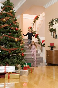 Home and Christmas tree decorated for the holidays Stock Image Christmas Colors, Christmas Themes, Christmas Tree Decorations, Holiday Images, Holiday Fun, Holiday Decor, Christmas Morning, Family Christmas, Foyer Decorating