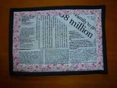 Quilted Mug rug. newsprint in black, white and pink