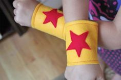 sewing + felt = super hero cuffs.  NEED... Any of my sewing crafty friends make a note I am in need of these however I would like a dark yet bold pink on black color scheme...